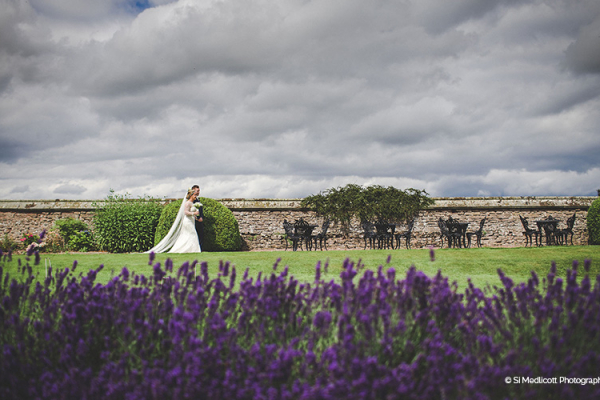 A happy couple in the beautiful gardens at Rowton Castle wedding venue in Shropshire | CHWV