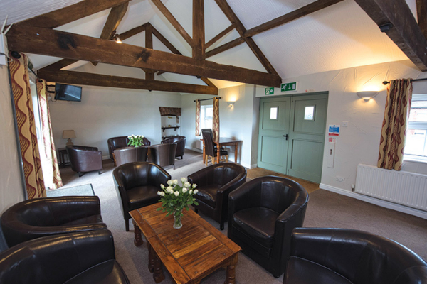 A room for guests to relax in at Sandhole Oak Barn