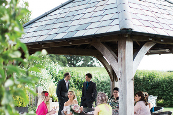 An outdoor wedding ceremony at Sandhole Oak Barn