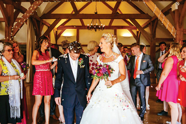A happy couple just married at Sandhole Oak Barn in Cheshire