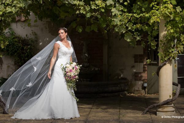 A pretty bride in the grounds of Sedgeford Hall