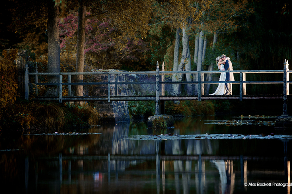 A couple on the bridge over the river at Slaugham Place