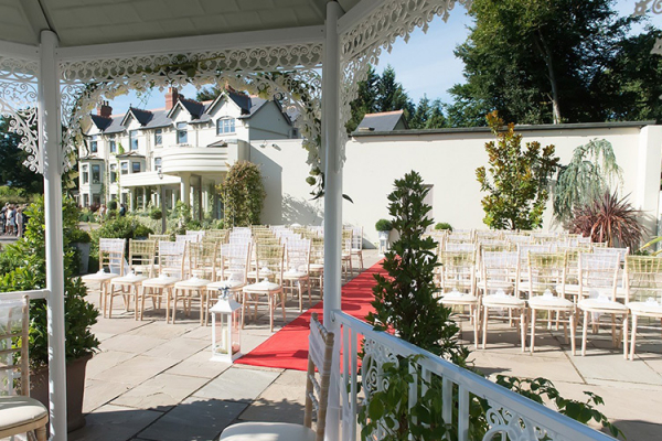 Set up for an outdoor wedding ceremony at Southdowns Manor wedding venue in West Sussex | CHWV
