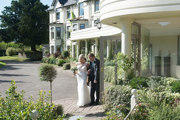 A happy couple outside Southdowns Manor wedding venue in West Sussex | CHWV