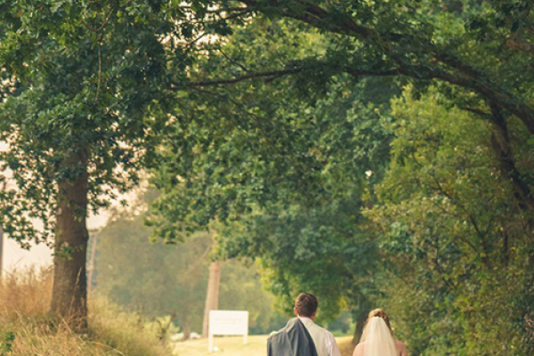 A happy couple in the grounds at Southdowns Manor wedding venue in West Sussex | CHWV
