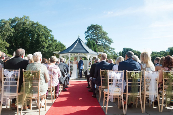 An outdoor wedding ceremony at Southdowns Manor wedding venue in West Sussex | CHWV