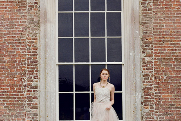 A happy bride outside St Giles House wedding venue in Dorset | CHWV