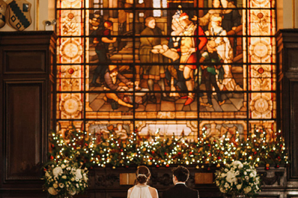 A wedding ceremony stained glass window at Stationers' Hall and Garden wedding venue in London | CHWV