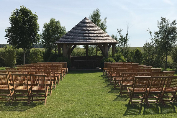Set up for an outdoor wedding ceremony at The Stone Barn wedding venue in Gloucestershire | CHWV
