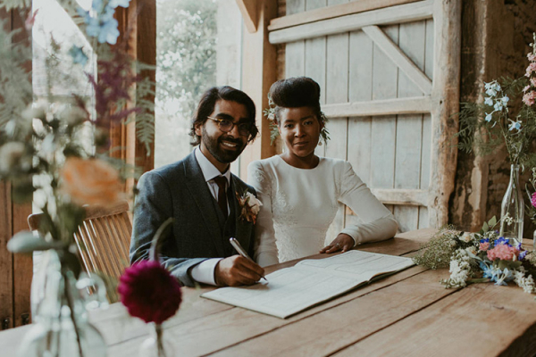 Signing the register at The Stone Barn wedding venue in Gloucestershire | CHWV