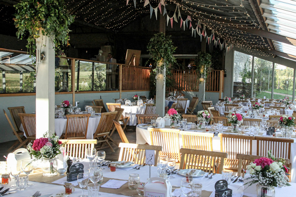 Set up for a wedding breakfast at The Stone Barn wedding venue in Gloucestershire | CHWV