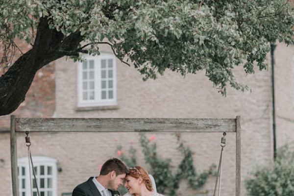 A couple taking a moment in the gardens at Stratton Court Barn wedding venue in Oxfordshire | CHWV