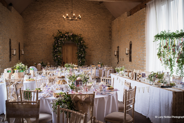 Set up for a wedding breakfast at Stratton Court Barn wedding venue in Oxfordshire | CHWV
