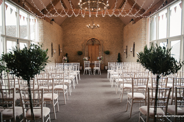Set up for a wedding ceremony at Stratton Court Barn wedding venue in Oxfordshire | CHWV