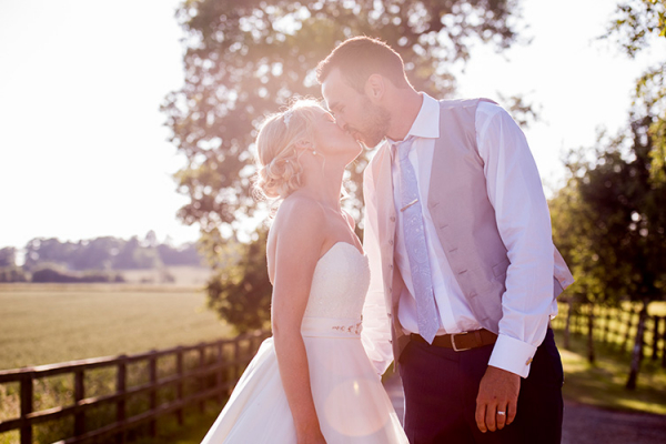 A happy couple taking a moment at Stratton Court Barn wedding venue in Oxfordshire | CHWV