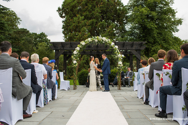 An outdoor ceremony at Swynford Manor wedding venue in Cambridgeshire | CHWV