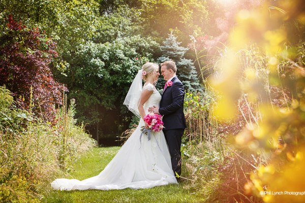A happy couple in the grounds at That Amazing Place in Essex | CHWV