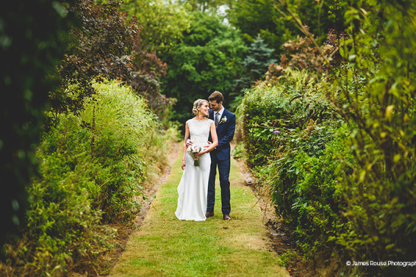 A happy couple in the grounds at That Amazing Place wedding venue in Essex | CHWV