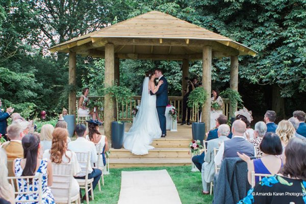 An outdoor ceremony at That Amazing Place wedding venue in Essex | CHWV