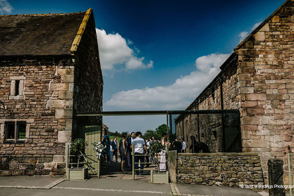Drinks reception in the courtyard at The Ashes barn wedding venue in Staffordshire | CHWV