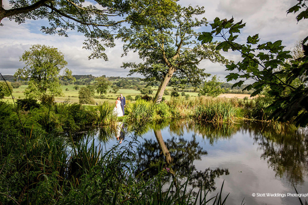 A happy couple in the beautiful gardens at The Ashes barn wedding venue in Staffordshire | CHWV