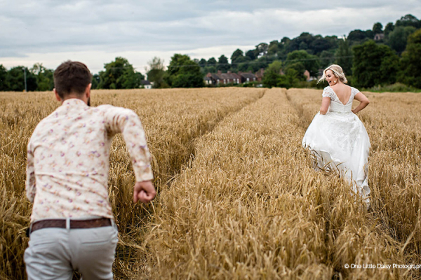 A happy couple in the corn fields at The Ashes barn wedding venue in Staffordshire | CHWV