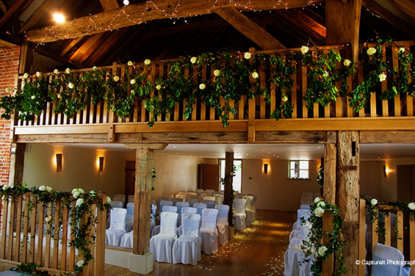 The Barn at Bury Court set up for a wedding ceremony