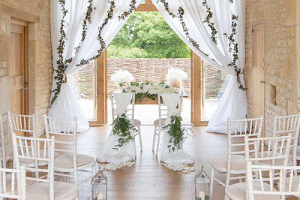 Set up for a ceremony at The Barn at Upcote wedding venue in Gloucestershire | CHWV