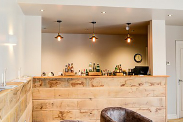 The bar at The Barn at Upcote wedding venue in Gloucestershire | CHWV