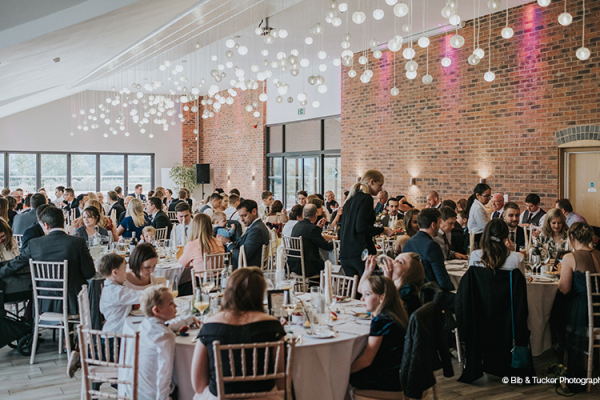 Guests enjoying a wedding breakfast at The Boat House garden wedding venue in Staffordshire | CHWV