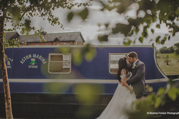 A couple taking a moment by the canal at The Boat House garden wedding venue in Staffordshire | CHWV