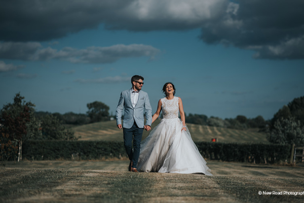 A couple taking a romantic stroll at The Boat House garden wedding venue in Staffordshire | CHWV