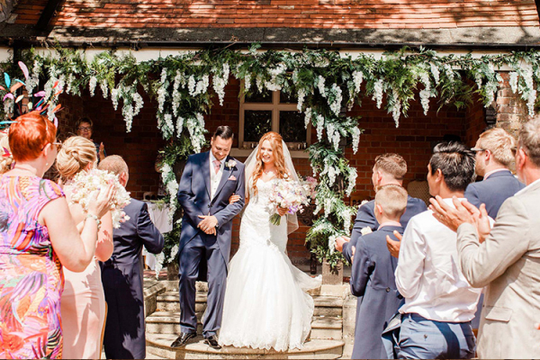 An outdoor wedding ceremony at The Elvetham country house wedding venue in Hampshire | CHWV