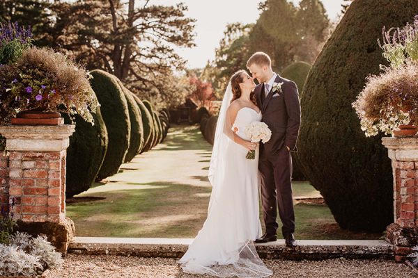 A couple taking a moment at The Elvetham country house wedding venue in Hampshire | CHWV