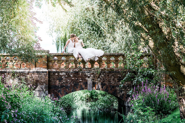 A happy couple taking a moment at The Elvetham country house wedding venue in Hampshire | CHWV
