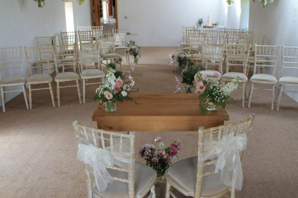 The Granary at Fawsley set up for a wedding ceremony