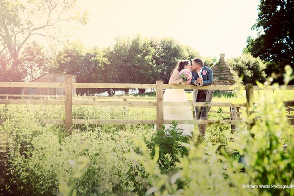 A happy couple in the grounds at The Granary at Fawsley in Northamptonshire