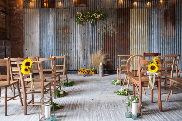 The Ristic Barn set up for a ceremony at The Green wedding venue in Cornwall | CHWV