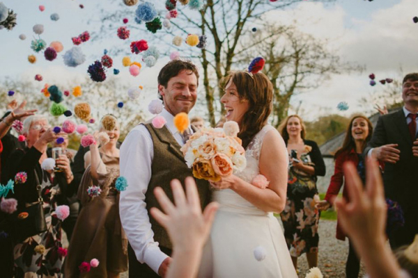 A happy couple showered with confetti at The Green wedding venue in Cornwall | CHWV