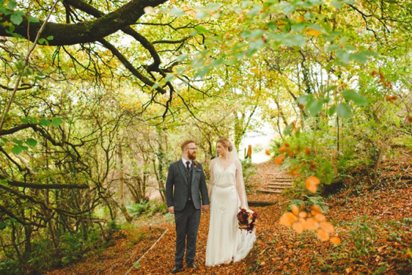 A happy couple taking a stroll at The Green wedding venue in Cornwall | CHWV