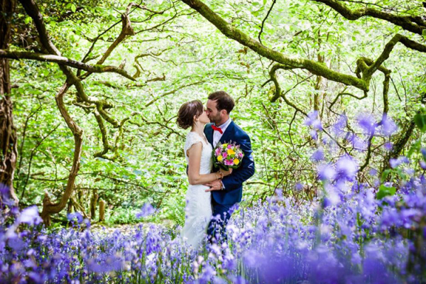 A happy couple taking a moment amongst bluebells at The Green wedding venue in Cornwall | CHWV