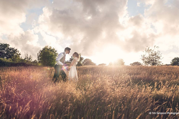 A happy couple taking a moment in the cornfields at The Green wedding venue in Cornwall | CHWV
