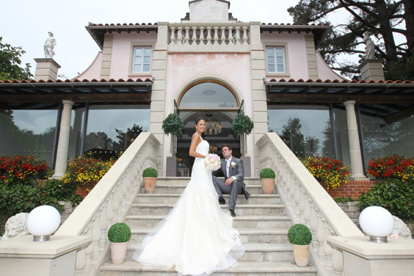A happy couple on the steps of The Italian Villa in Dorset