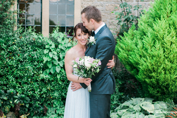 A couple taking a moment at The Pear Tree wedding venue in Wiltshire | CHWV