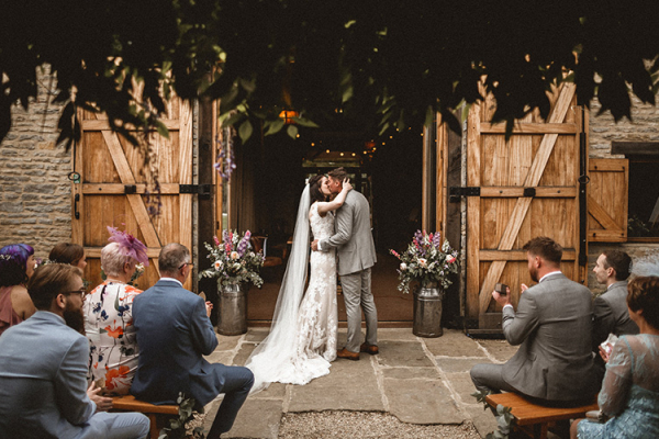 An outdoor wedding ceremony at The Tythe Barn wedding venue in Oxfordshire | CHWV