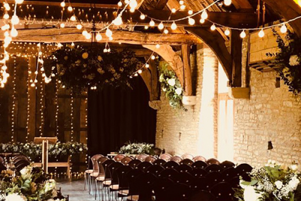 Set up for a wedding ceremony at The Tythe Barn wedding venue in Oxfordshire | CHWV