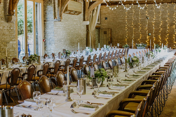 Set up for a wedding reception at The Tythe Barn wedding venue in Oxfordshire | CHWV