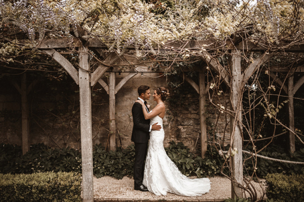 A happy couple taking a moment at The Tythe Barn wedding venue in Oxfordshire | CHWV