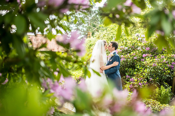 Ahappy couple in the grounds at Thursford Garden Pavilion in Norfolk | CHWV