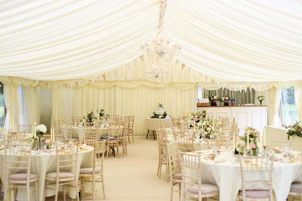 The marquee set up for a wedding breakfast at Tofte Manor country house wedding venue in Bedfordshire | CHWV